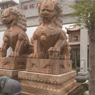 镇宅石狮子_大型晚霞红石雕动物