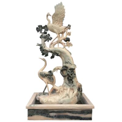晚霞红石雕仙鹤雕塑