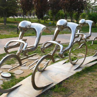 不锈钢骑行人物_体育公园骑自行车的运动人物雕塑